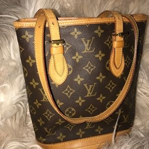 Authentic Louis Vuitton PM bucket bag. No lining.